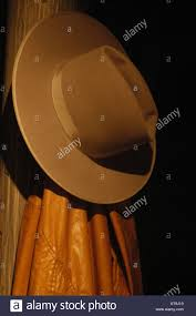 Cowboy Coat Rack american cowboy hat and classic long duster hanging on coat rack 44