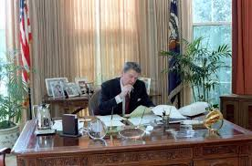 President Ronald Reagan Working in the White House Oval Office