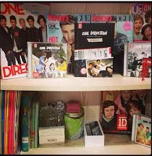 A Few Shelves W/ A Bunch Of One Direction Stuff On It