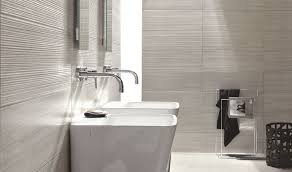 related images. Sleek modern dark bathroom with glossy tiled ...