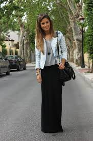 denim washed blue biker jacket is worn atop gray pullover teamed with black maxi skirt