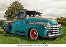 vintage chevrolet truck logo. vintage car rally in aylesbury buckinghamshire may 15 2016 restored blue chevrolet truck on logo a