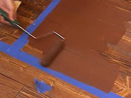 use a roller to create a faux painted rug
