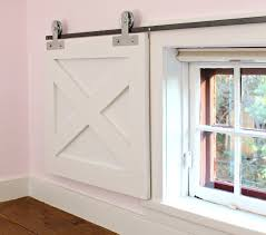 once the bar is installed place the barn door in position and attach the pulley wheel to the t strap using the axle bolts