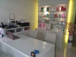 elegant hair salon interior design ideas with white reception desk and glowing display
