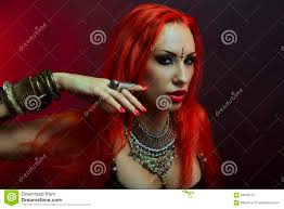 beautiful redhead young woman in clothing with eastern makeup and luxury oriental jewelry beautiful hot bollywood dancer sensitive bellydancer