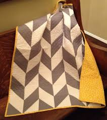 The Herringbone Quilt Pattern | Supply | Patterns | Kollabora & This quilt pattern is a variation of the very popular chevron pattern. The  herringbone pattern is interesting and unusual while keeping the clean  lines of ... Adamdwight.com
