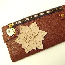pouch with a laser cut leather decoration