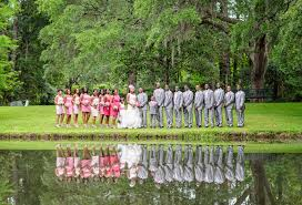 beautiful wedding party pictures reflecting in the lake at the holiday cottage in brookgreen gardens