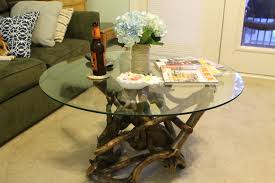 saving small living room spaces with crate and barrel driftwood coffee table base round glass top