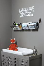 a railing with some metal crates as shelves is a very comfortable idea