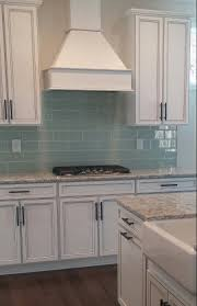 beautiful white kitchen cabinet with cambria quartz countertops and ice subway tile backsplash design