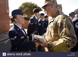 U.S. Army Maj. Gen. Greg Lusk (right), adjutant general of North Carolina,  awards Airman 1st Class Abigail Nichols, 145th Civil Engineer Squadron,  with Airman of the Quarter during a ramp formation held