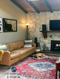 stone wall fireplace in living room vaulted wood ceiling beams whitewashed with revere pewter benjamin moore pashmina paint on wall kylie m e design