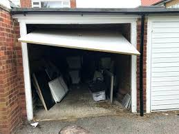 close genie garage garage door will not open all the way when cold my