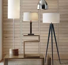 View in gallery Wood paneling behind a collection of lamps