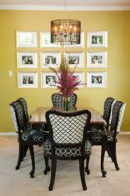 antique dining table and chairs transformed with new trellis patterned upholstery and black lacquer