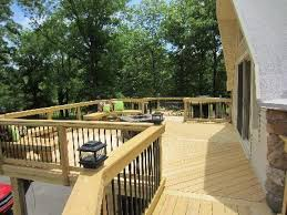 This wrap around deck has a large sitting area with wooden benches.