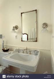 over mirror lighting bathroom. Glass Shades On Chrome Wall Lights Either Side Of Mirror Above Within Size 962 X Over Lighting Bathroom E