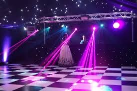 lighting over black and white dance floor