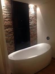the o hotel bathtub in hotel room