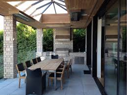 dining patio with ceiling mounted w series heaters photo via realm architecture design