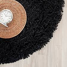 safavieh california cozy solid black shag rug 4 round 14213459 overstockcom shopping great deals on safavieh roundovalsquare california shag black 4 ft