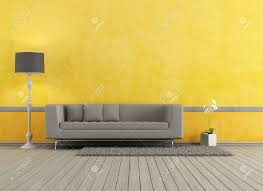 Yellow Living Room Gray Modern Sofa In A Yellow Living Room Rendering Stock Photo