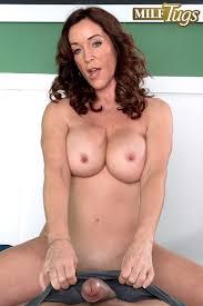 MILF Tugs Rachel Steele Rachel Tugs Blows And Uses Her Feet Too.