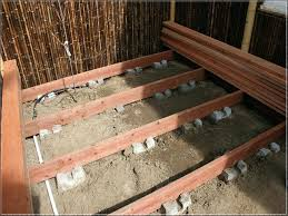 building a deck on the ground concrete deck blocks how to build a ground level deck