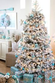 This flocked coastal themed Christmas tree is decorated with pretty  turquoise ornaments in light and dark shades. Apart from the baubles, clay  starfish ...