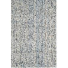 safavieh abstract 6 x 9 hand tufted wool rug in dark blue and rust