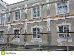 Painting Stucco And Plastering Exterior House Scaffolding Facade - Plastering exterior walls