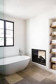 Bathroom: Sleek And Modern Bathroom With Fireplaces - Bathroom Fireplace  Ideas