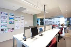 Small office space design Space Saving Small Office Interior Designstraight Workstations Lisa Elliott Interior Design 10 Ways To Save On Office Space For Your Small Business Lisa