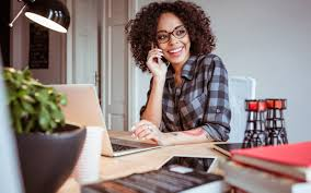 working for home office. Young Woman Making A Phone Call From Home Office Working For L
