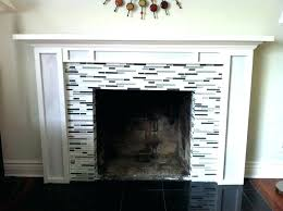 tile surround fireplace black and white grey small glass tile mosaic surround fireplace with cement mantel