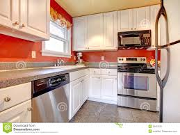 Cozy Kitchen Cozy Kitchen Room With Red Wall And White Cabinets Stock Image
