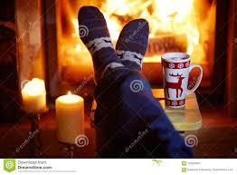 Lighting Socks On Fire Man S Feet In Warm Socks With Large Mug Of Hot Chocolate And