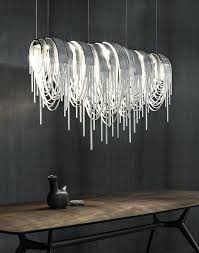this dazzling chandelier has been made from thin nickel chains with led lighting