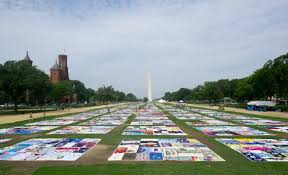 The AIDS Memorial Quilt, too large for even the National Mall, is ... & A section of the AIDS Quilt is laid out on the National Mall July 23, 2012  as part of the 19th International AIDS Conference in Washington, DC. Adamdwight.com