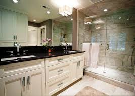white cabinets and black countertops bathroom