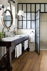 rustic bathroom. rustic master bathroom with hardwood floors, mid-century overarching wall sconce,