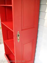diy decorating ideas repurpose an old door into a bookcase by cutting it in half and adding shelves finish it off with a vibrant high gloss color to give