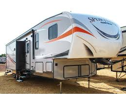 2019 kz rv sportster 363th12 with orange stripes parked in a dealership lot toy haulers provide that extra legroom
