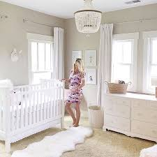 this sweet mama is all ready for baby loving calm white within chandelier nursery ideas 13