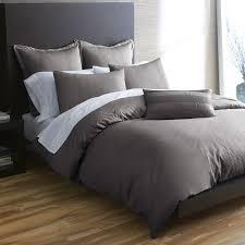 dark gray bedding with light walls