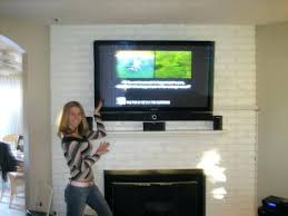 mount tv on fireplace brick perfect mounted above a brick tv wall mount on brick fireplace we