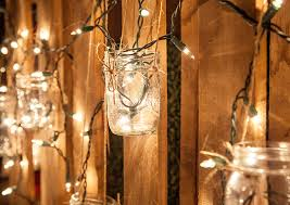 Mason jars and white icicle lights create a chic rustic lighting design.  Try this and