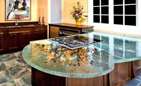 glass countertop artistic abstract swirls out from stovetop on round end island